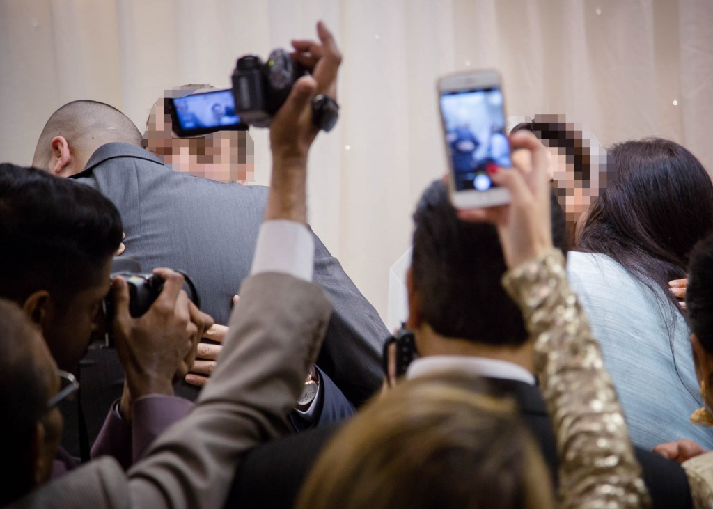 'Handy' video camera and mobie phone blocking a crucial moment during a wedding