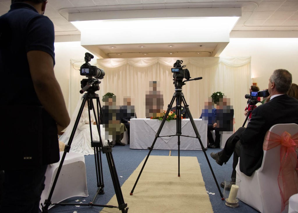 Videographers blocking the aisle during a wedding ceremony