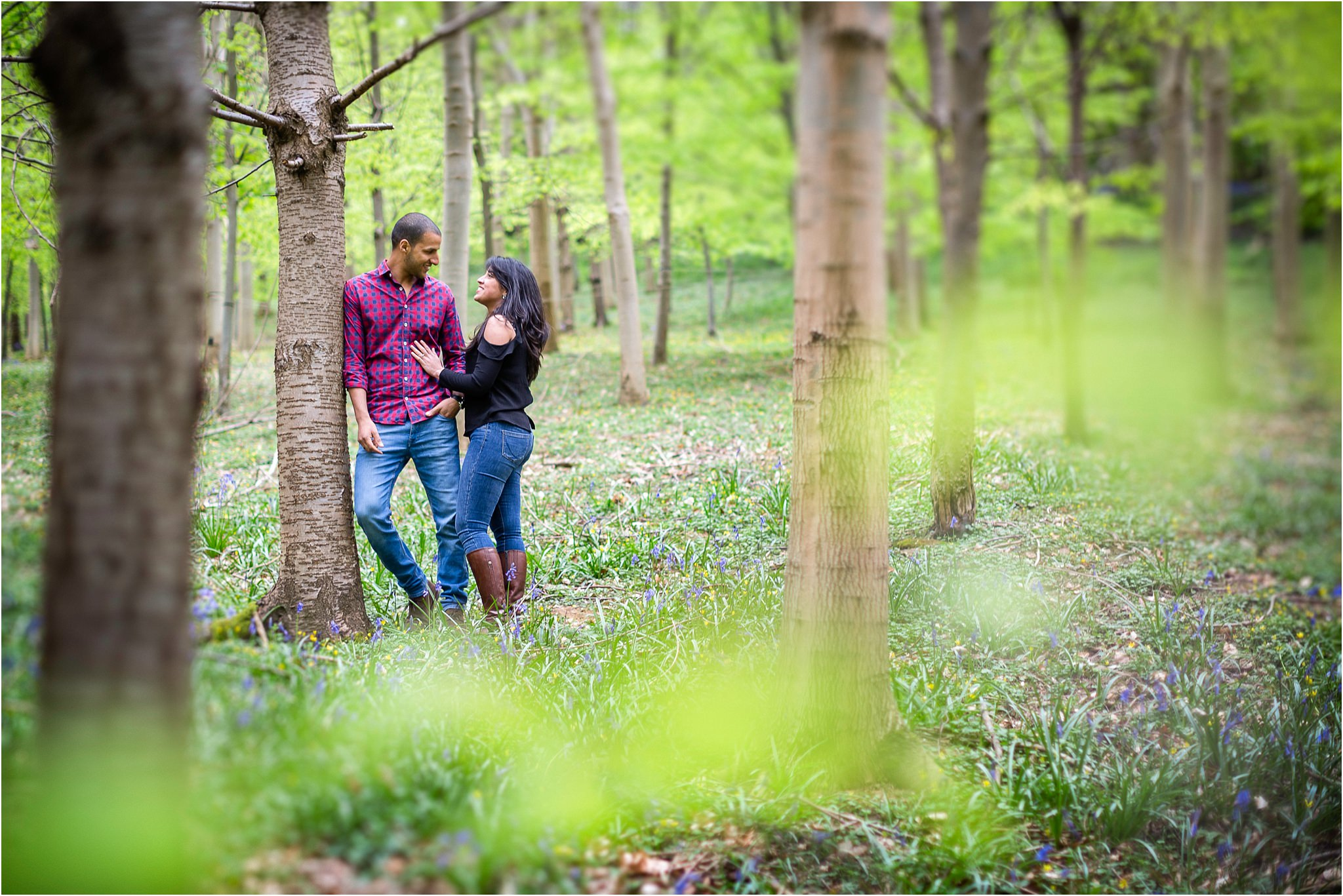 A couple in woods during their pre wedding shoot at The Fish Hotel in the Costwolds.