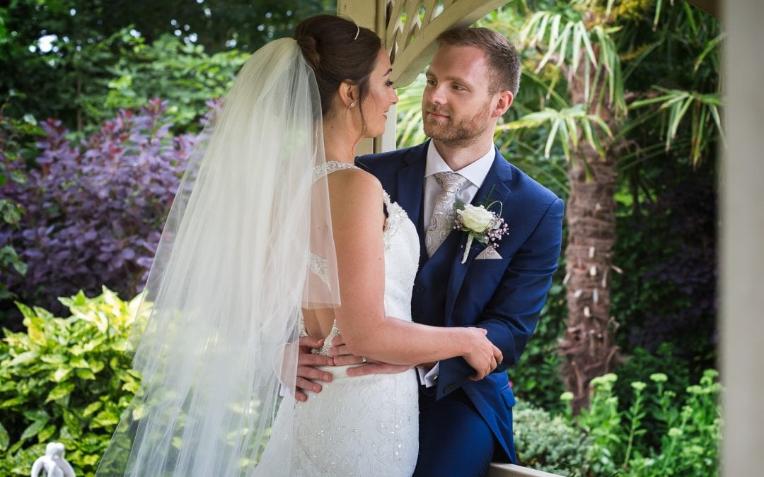 A couple embracing in a gazebo at Warwick House in Southam.