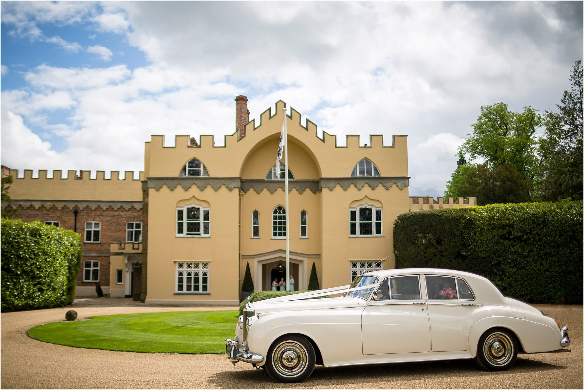 a photo of a vintage car pulling up to a grand venue. Image by S2 Images, Hampden House Wedding Photographer