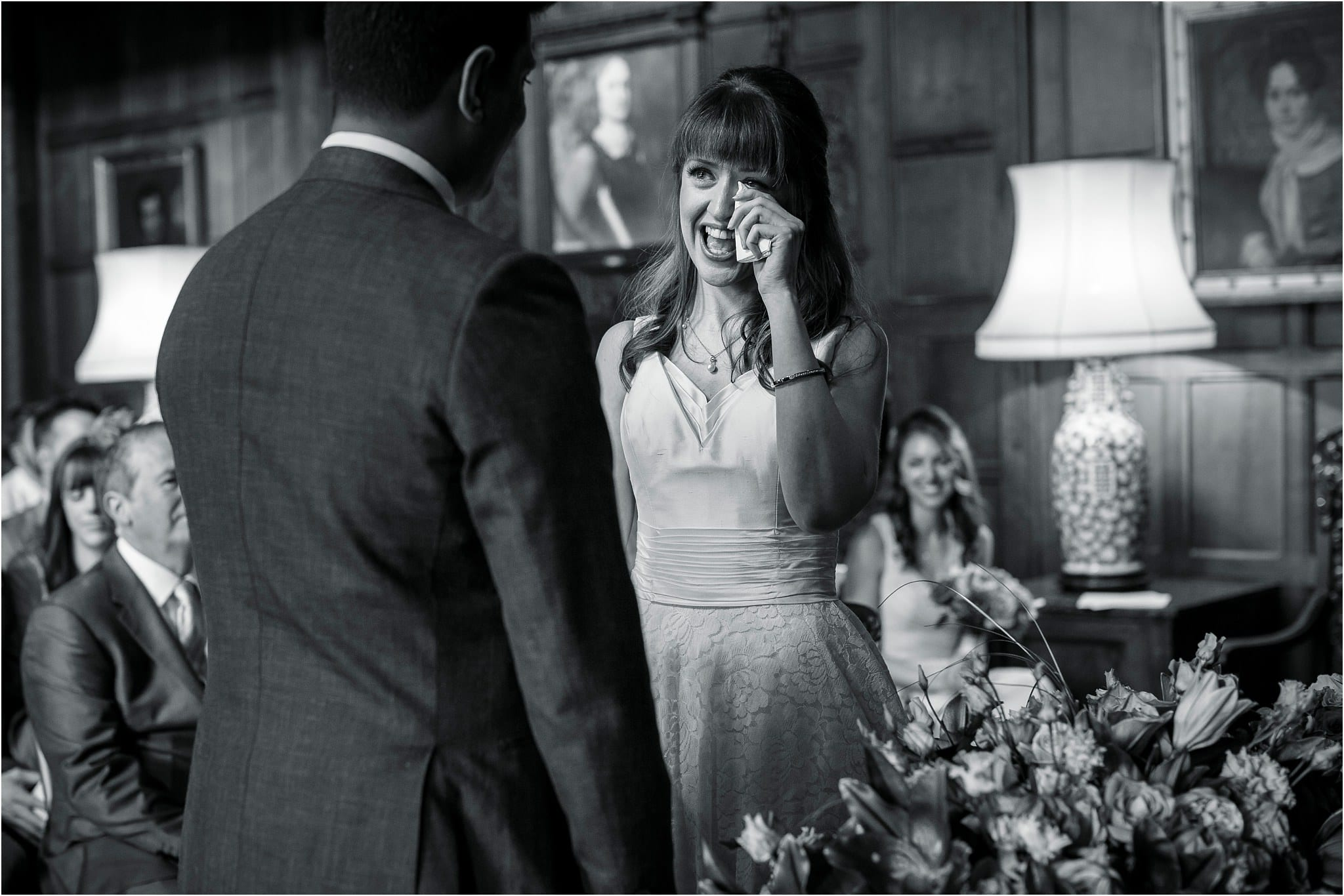 A black and white image of a bride getting emotional saying her vows. Image by S2 Images, Hampden House Wedding Photographer