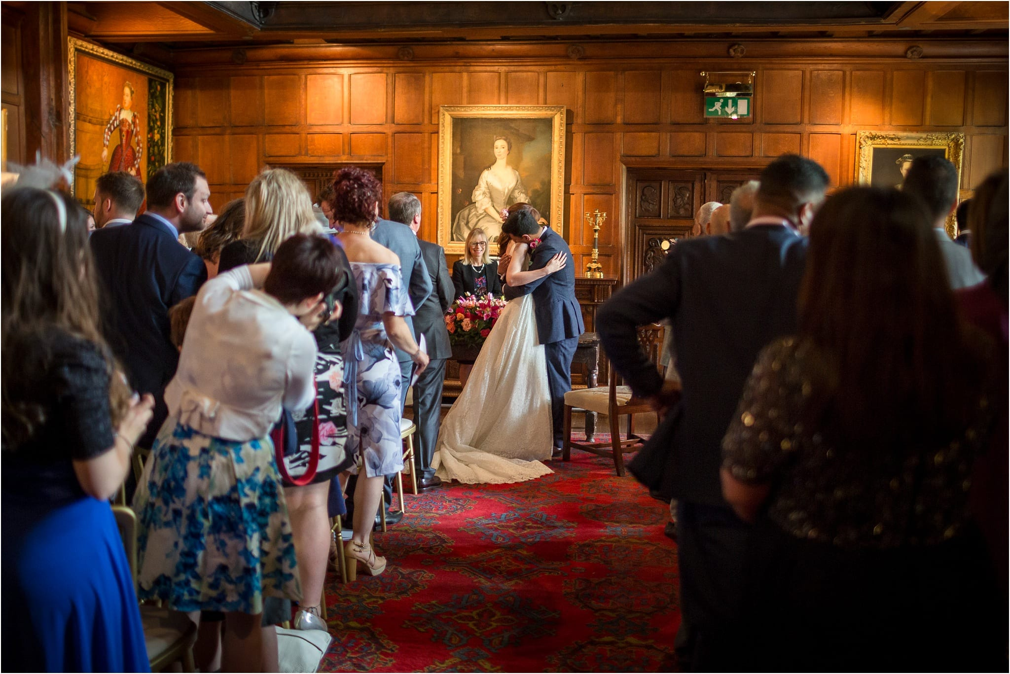 A couple hugging after saying their wedding vows. Image by S2 Images, Hampden House Wedding Photographer