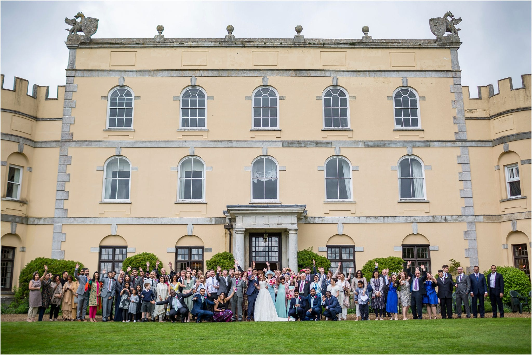 Guests in front of a grand wedding venue. Image by S2 Images, Hampden House Wedding Photographer