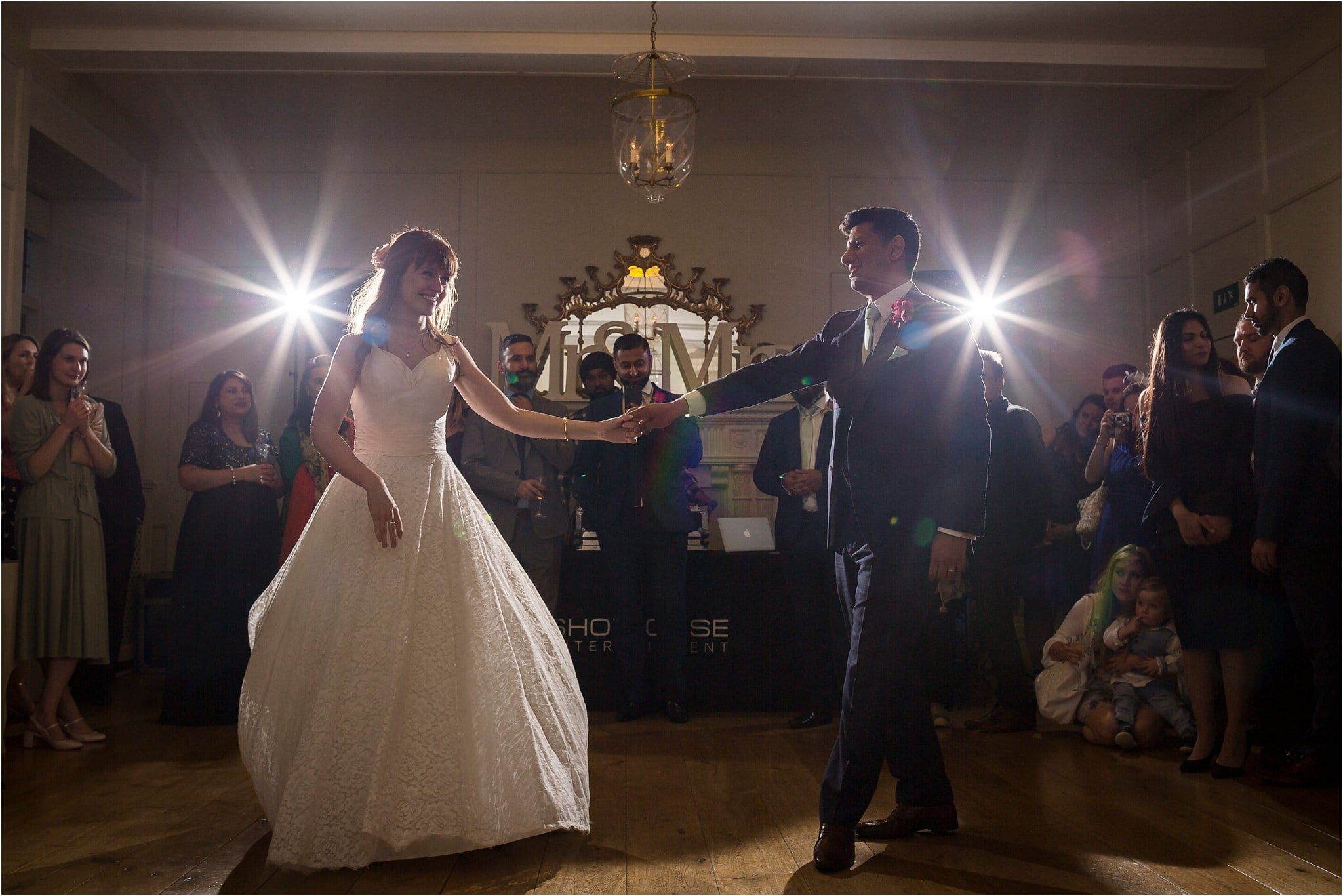 A couple performing their first dance on their wedding day with star lights in the background. Image by S2 Images, Hampden House Wedding Photographer