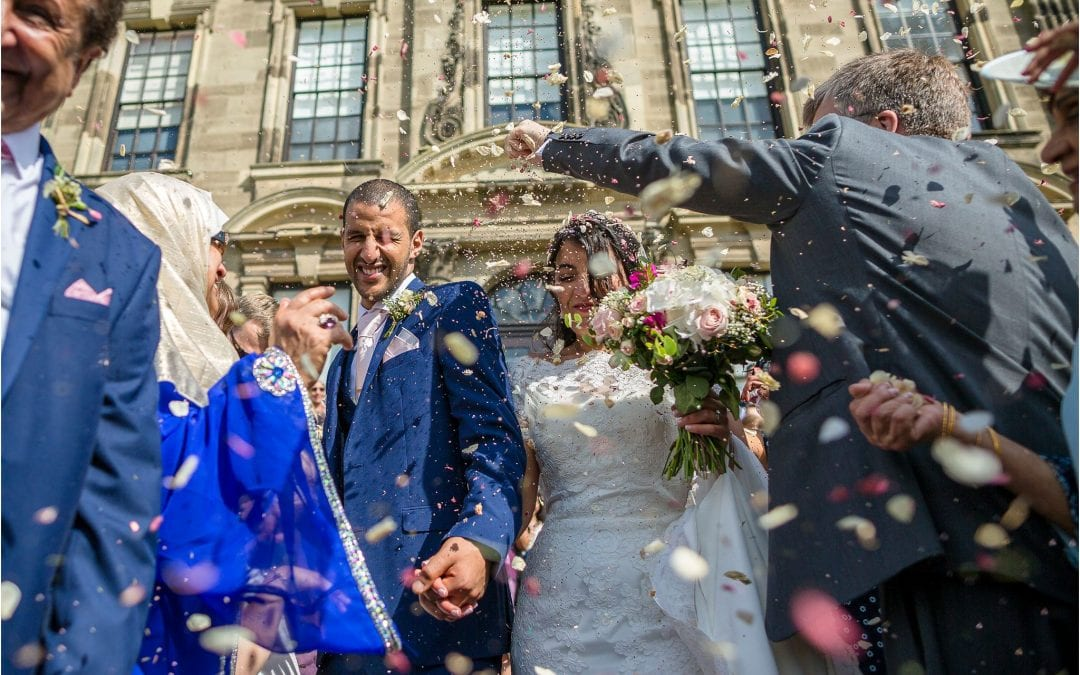 excessive confetti being thrown during a grand wedding at stoneleigh abbey in warwickshire