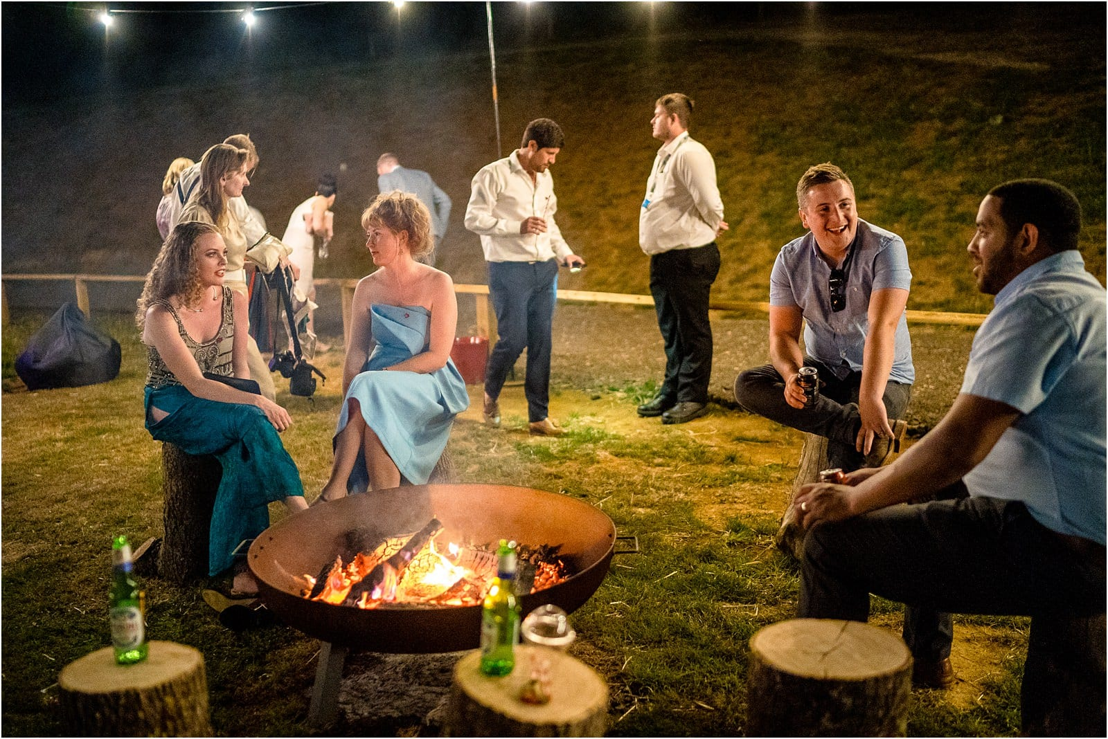 oxfordshire wedding guests around a firepit