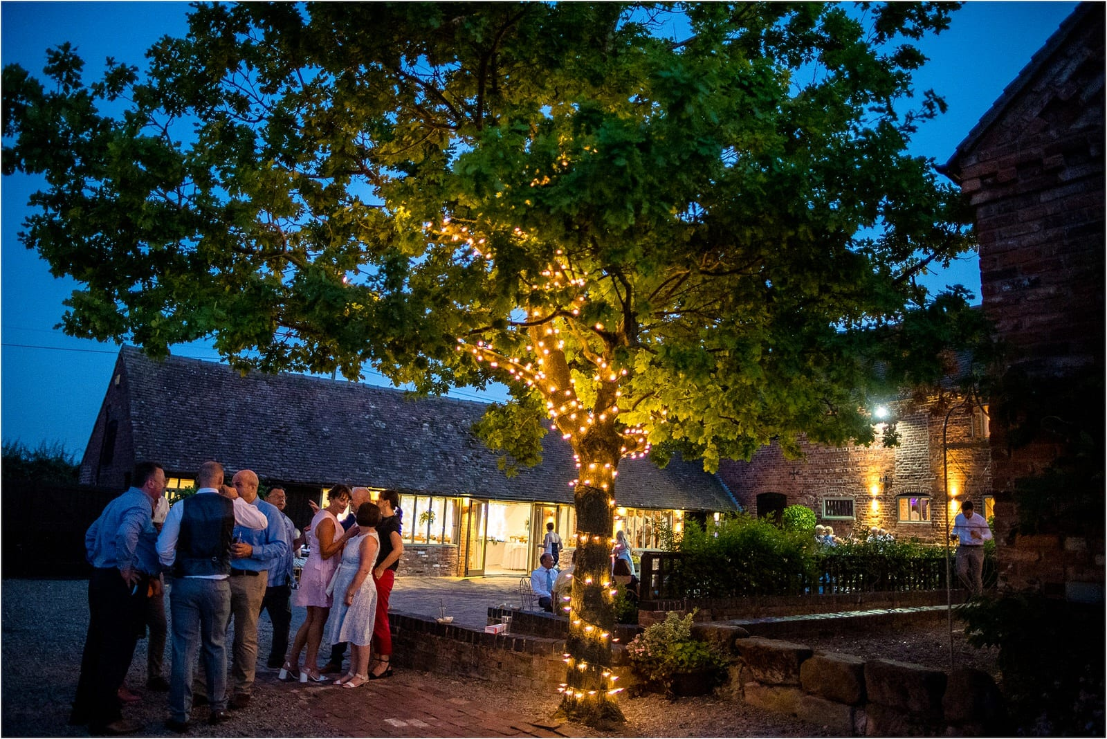 evening image of curradine barns wedding venue in worcestershire