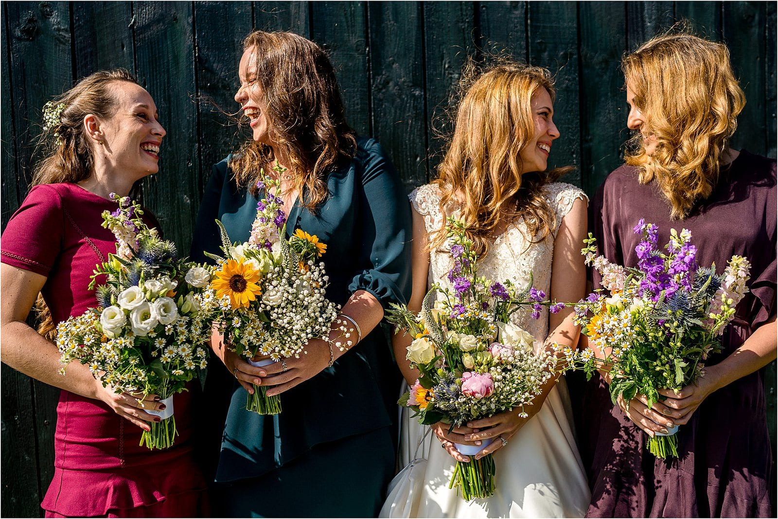 where to start with wedding planning - newly engaged - image of bride with bridesmaids laughing