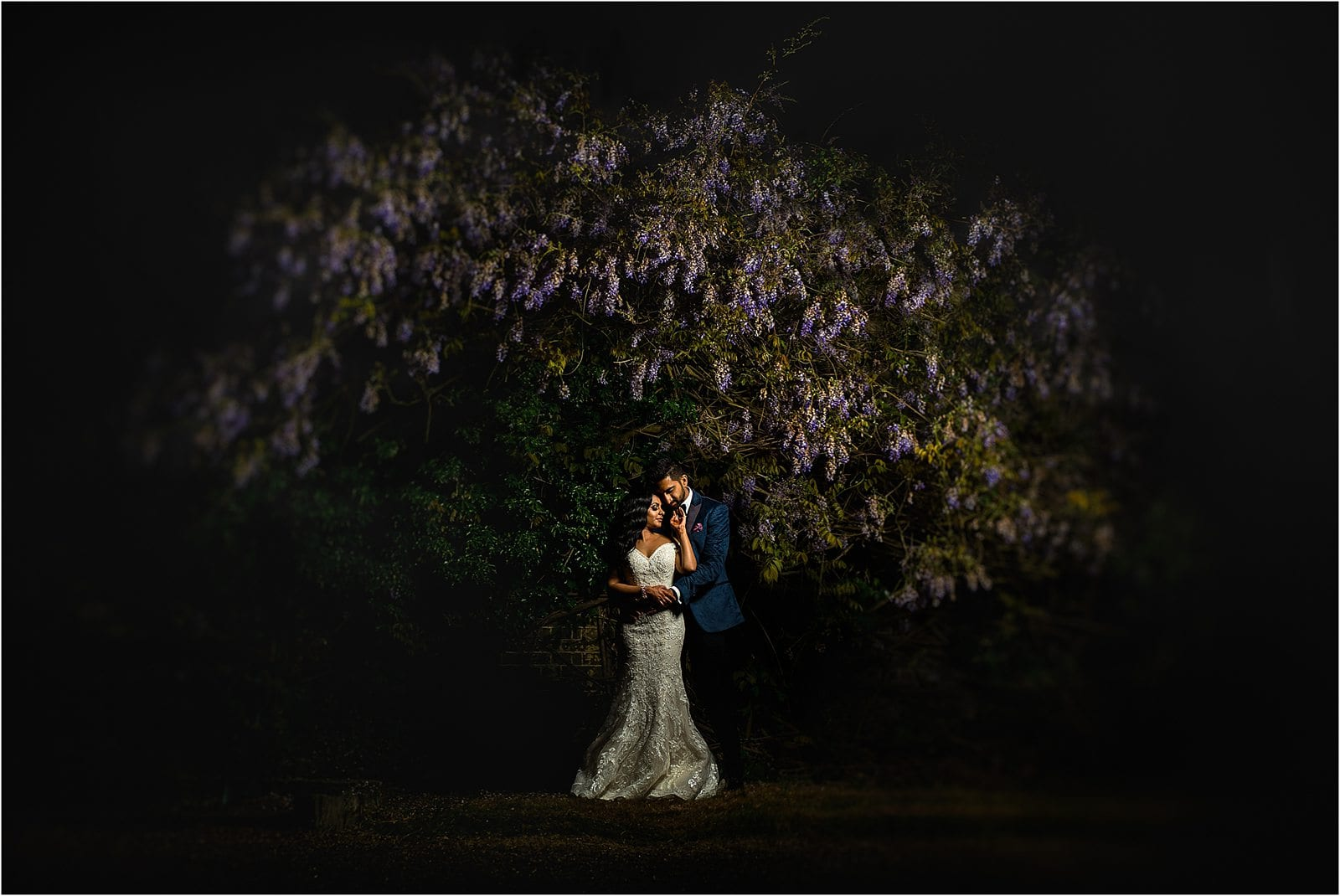 best wedding photography in warwickshire - bride and groom under a tree at nighttime