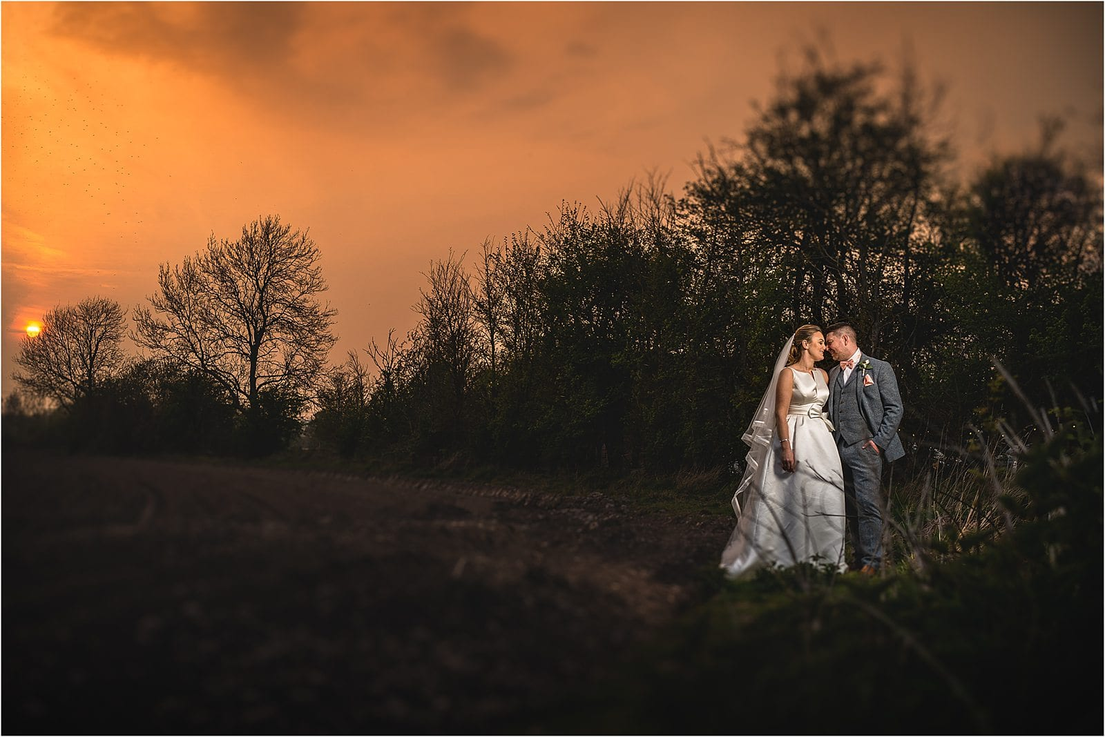 bride and groom at shustoke farm barn wedding in warwickshire